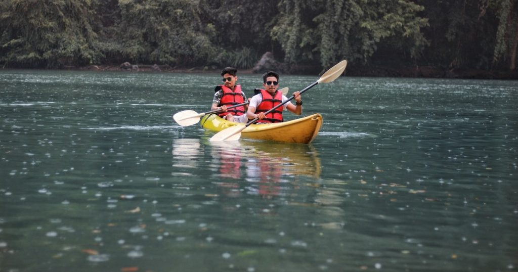 two person kayaking on calm water